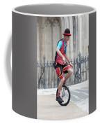 Clown Riding Unicycle In Town Coffee Mug