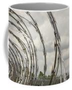 Coils Of Razor Wire On Fence Coffee Mug