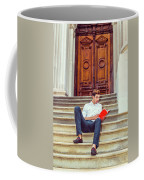 College Student Reading Red Book, Sitting On Stairs, Relaxing Ou Coffee Mug