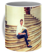 College Student Sitting On Stairs, Relaxing Outside Coffee Mug