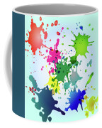 Colored Splashes On A Very Beautiful Blue Background Coffee Mug