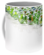 Composition With Green Marbles On White Background Coffee Mug