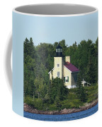 Copper Harbor Island Lighthouse Coffee Mug by Sally Sperry