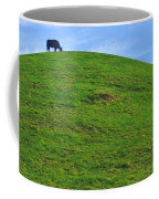 Cow Eating On Round Top Hill Coffee Mug