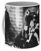 Criminal Being Held Down For Mug Shot Coffee Mug by Photo Researchers