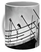 Crow Watches Over Coffee Mug