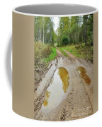 Dirty Autumn Road With Brown Pools After Rain Coffee Mug