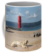 Dog Lying On The Beach In Front Of Red Lighthouse Of Cres Coffee Mug