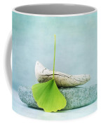 Driftwood Stones And A Gingko Leaf Coffee Mug by Priska Wettstein