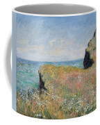 Edge Of The Cliff Pourville Coffee Mug by Claude Monet
