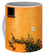 Eighteen On Orange Wall Coffee Mug