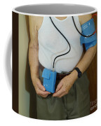 Elderly Man Wearing A Blood Pressure Coffee Mug