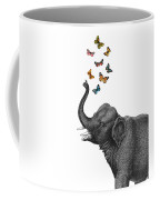 Elephant Blowing Butterflies From His Trunk Coffee Mug