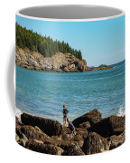 Exploring Rocks At Sand Beach Coffee Mug