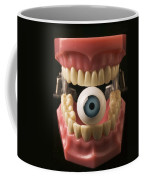 Eye Held By Teeth Coffee Mug