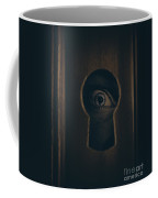 Eye Looking Through Door Keyhole Coffee Mug