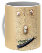 Face On The Sand Coffee Mug