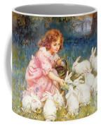 Feeding The Rabbits Coffee Mug by Frederick Morgan