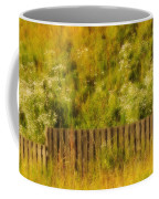 Fence And Hillside Of Wildflowers On Suomenlinna Island In Finland Coffee Mug