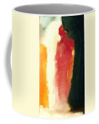 Figure In Orange And Black Coffee Mug
