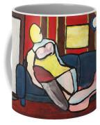 Figure On Couch Coffee Mug