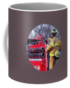 Fireman On Back Of Fire Truck Coffee Mug