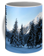 Firs In The Snow Coffee Mug