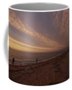 Fishermen Fishing In The Surf At Sunset Coffee Mug