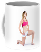 Fitness Woman Stretching Over White Coffee Mug