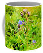 Flowers In The Garden Of Life Coffee Mug