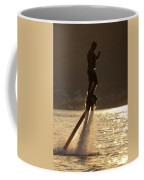 Flyboarder And Water Droplets Backlit At Sunset Coffee Mug