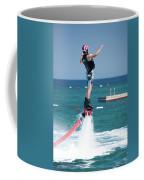 Flyboarder Falling Backwards Next To Swimming Platform Coffee Mug