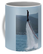 Flyboarder In Silhouette Balancing High Above Water Coffee Mug