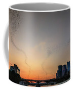 From The Congress Avenue Bridge, Silhouetted Crowds And Onlookers Watch Mexican Free-tailed Bats Stream Into The Sunset For A Night Of Consuming Insects Coffee Mug