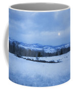 Full Moon Over A Field Of Snow Coffee Mug
