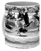 Geese On Ice Taking Flight Coffee Mug