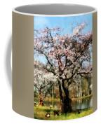 Geese Under Flowering Tree Coffee Mug