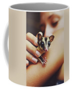 Girl Holding A Cute, Adorable And Curious Baby Sugar Glider Pet On Her Arm Coffee Mug