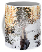 Girl Playing In The Snow In The Woods Coffee Mug