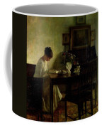 Girl Reading In An Interior  Coffee Mug by Carl Holsoe