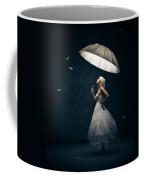 Girl With Umbrella And Falling Feathers Coffee Mug