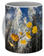 Golden Leaves Against A Muted Forest Coffee Mug