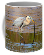 Great Blue Heron Wrestles A Snake Coffee Mug