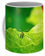 Green Creature On A Broad Leaf. Coffee Mug