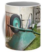Green Wheelbarrow Lying On A Green Meadow Coffee Mug