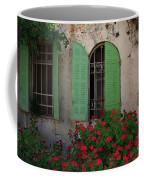 Green Windows And Red Geranium Flowers Coffee Mug