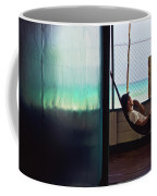 Guy With The Hat Lying In A Hammock On The Porch Of The Old House And Relaxing By The Caribbean Sea Coffee Mug
