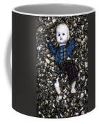 Half Buried Doll Coffee Mug