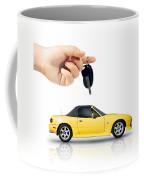 Hand Holding Key To Yellow Sports Car Coffee Mug