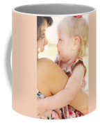 Happy Mother Holding Baby With Look Of Surprise Coffee Mug